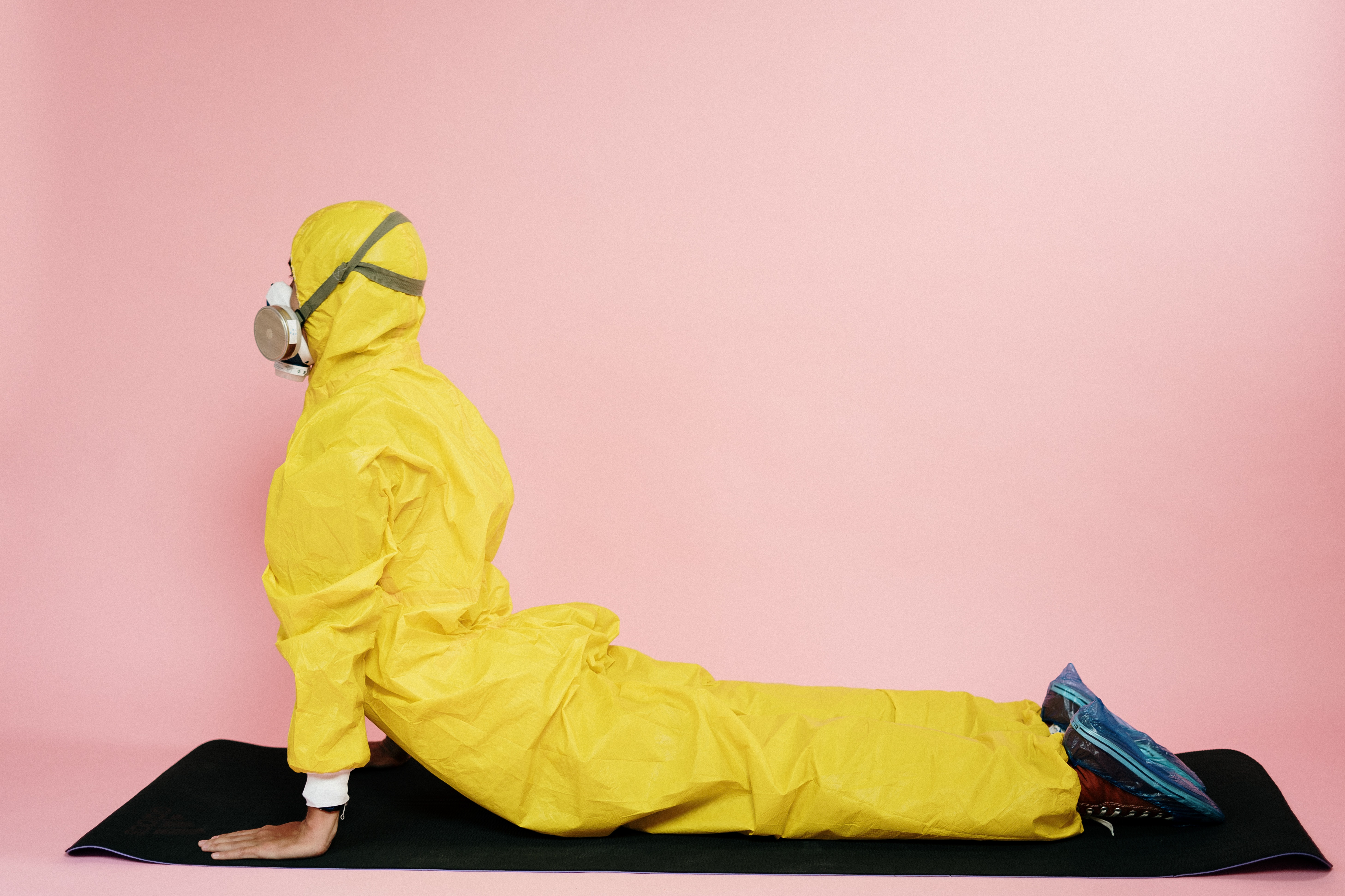 man-in-yellow-protective-suit-stretching-3951375